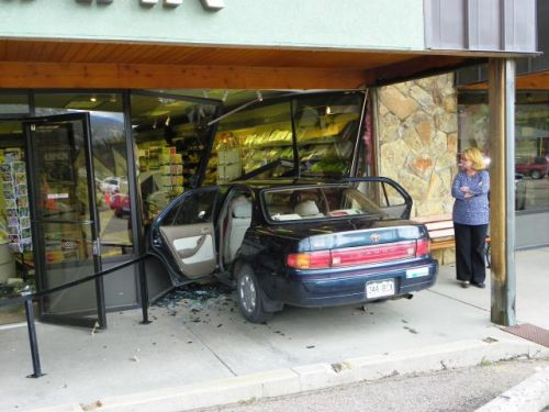 Toyota goes through the front of the Peaks Hallmark store in Estes Park