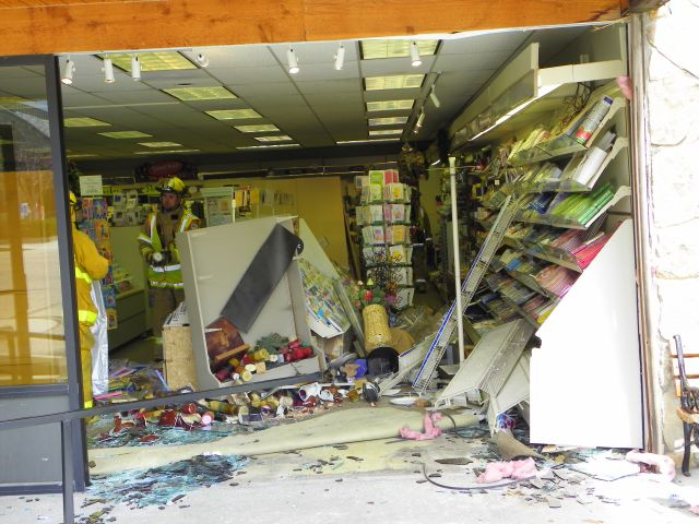 Front of the Peaks Hallmark store in Estes Park after the car was removed.