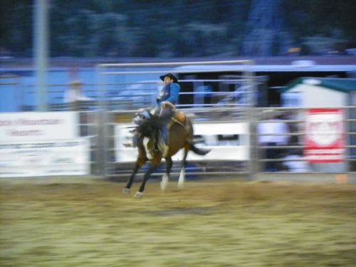 BAREBACK RIDER AT THE ROOFTOP RODEO IN ESTES PARK COLORADO